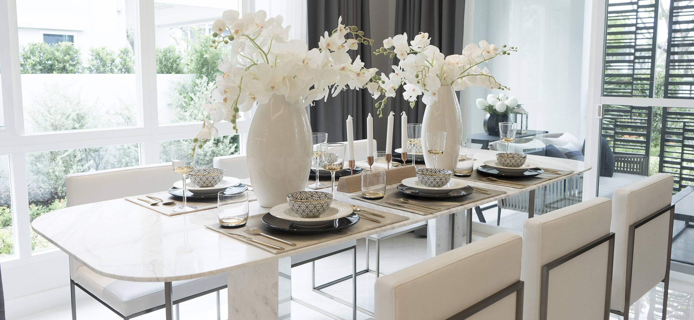 Beautiful Luxury Dining Table with Plate Settings at Home